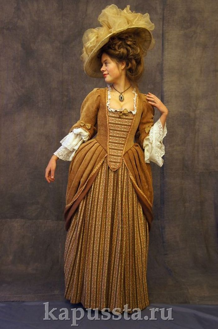The dress is baroque light brown