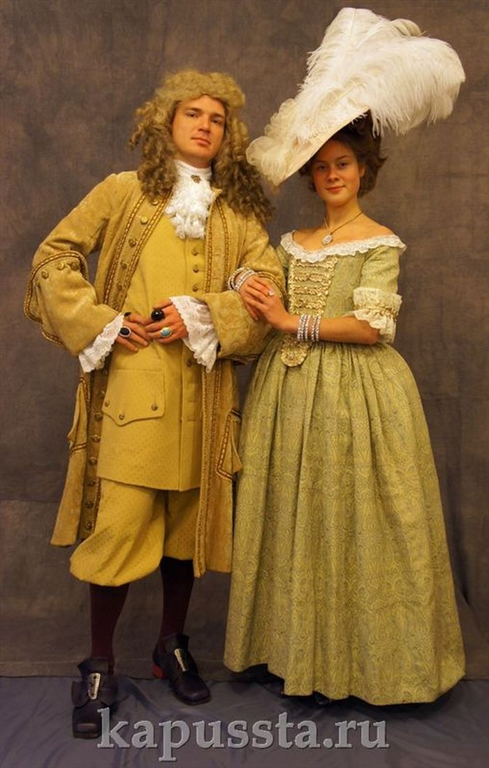 Historical costumes in wigs and hats