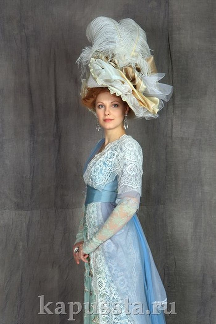 Blue cap with feathers and lace trim